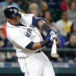 Seattle Mariners' Nelson Cruz in action against the Oakland Athletics in a baseball game Saturday, April 9, 2016, in Seattle.