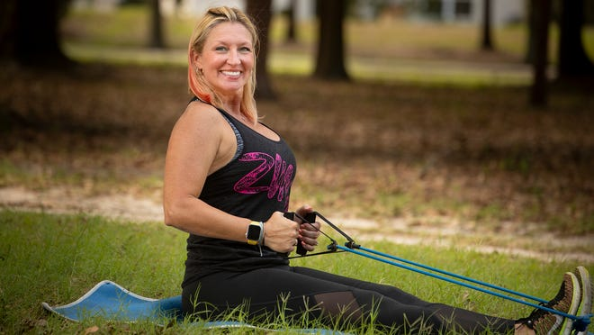 Marlo Alleva demonstrates a seated row with resistance band.