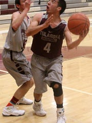 Cameron Sheppard, right, attempts a hook shot while being defended by teammate Robert Silva. No. 11 Tularosa travels to No. 6 Laguna Acoma on 4 p.m. Saturday for the first round of the 3A state playoffs.