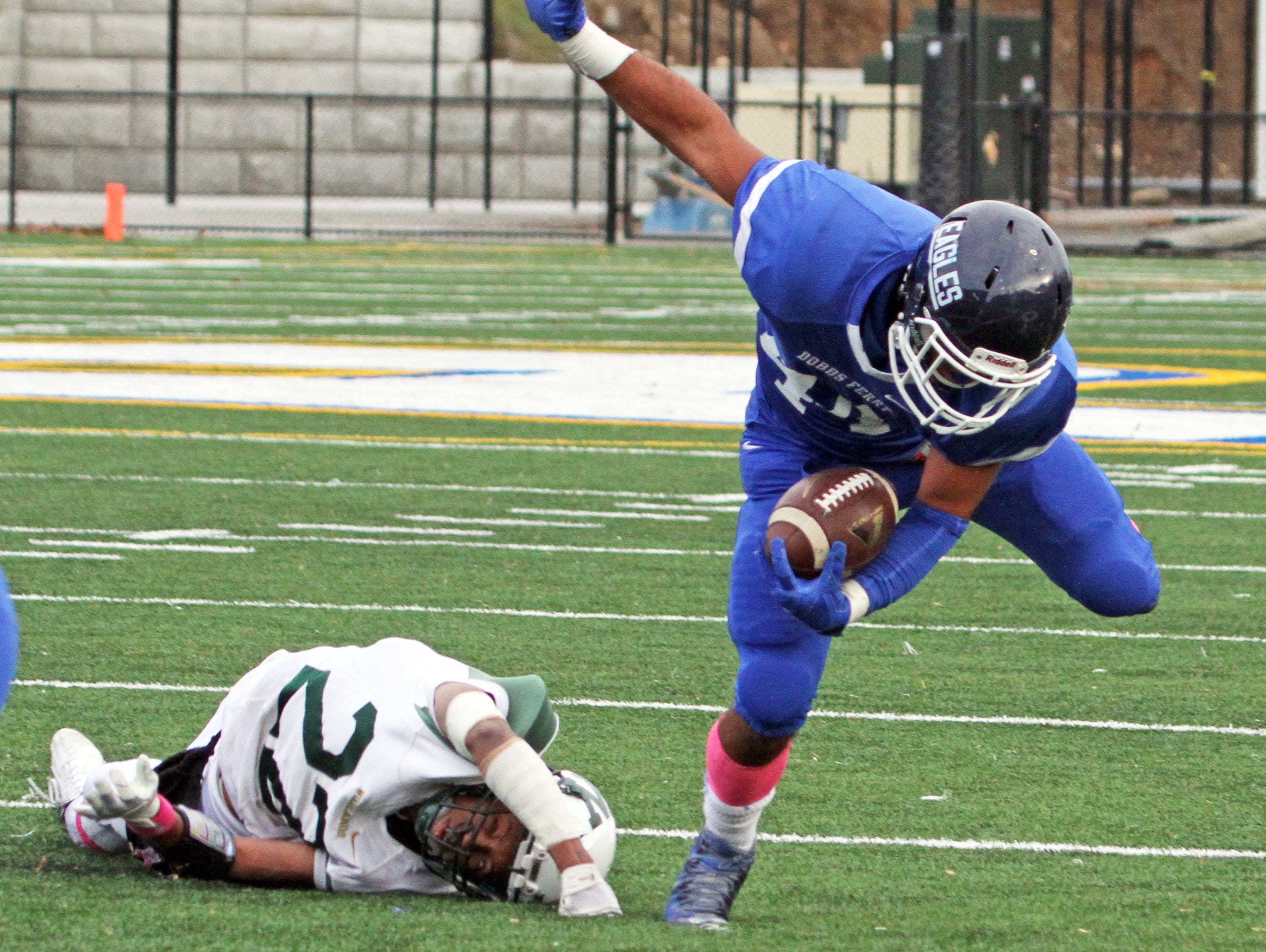 Jibral Kapadia of Dobbs Ferry evades Timothy Leak II of Woodlands for Dobbs Ferry's second touchdown during the Class C championship game at Pace University Oct. 31, 2015. Dobbs Ferry defeated Woodlands 35-0.