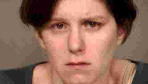 Holly Solomon, 28, was arrested Nov. 10 after she is suspected of chasing her husband Daniel Solomon, 36, in a parking lot on Gilbert Road near Vaughn Avenue, police said.