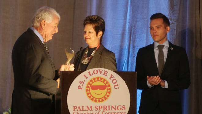 At center, Betty Callies receives the Athena Community Leadership Award at the 2015 Athena Luncheon at the Renaissance Palm Springs hotel on December 3, 2015.