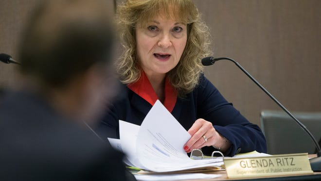 Glenda Ritz, Superintendent of Public Instruction for Indiana, addresses a concern from Gordon Henry, State Board of Education member, during a meeting about the ISTEP test, and length changes to it, Indianapolis, Friday, Feb. 13, 2015.