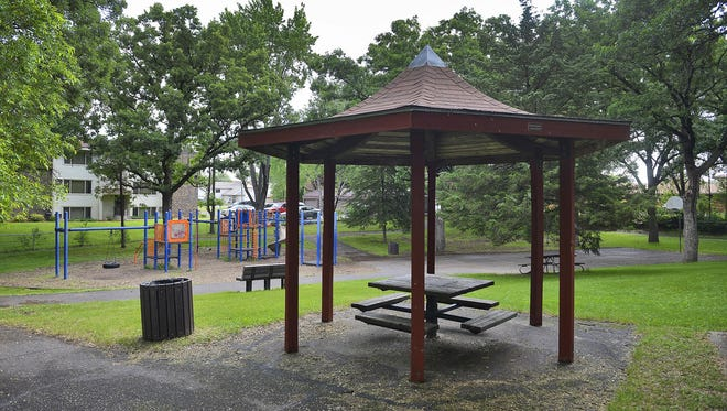 A gazebo presides over the difficult-to-find Goldthorpe Park at 10-12th Ave. NE on Wednesday in St. Cloud. The park offers a basketball court, playground equipment, picnic tables, benches, mature trees, a short perimeter trail, and a bit of respite from the hustle and bustle around it.