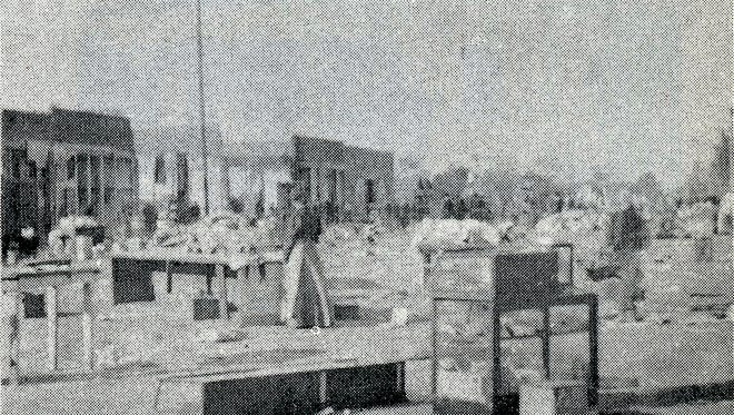 A women looks over a street littered with recovered pieces from a major fire downtown Mesa fire in 1901, similar to the 1898 blaze in which the southside of Main Street was nearly destroyed.