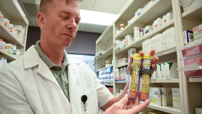 CentraCare Health Plaza pharmacy manager David Thomas holds a pack of EpiPens Wednesday, Aug. 24.