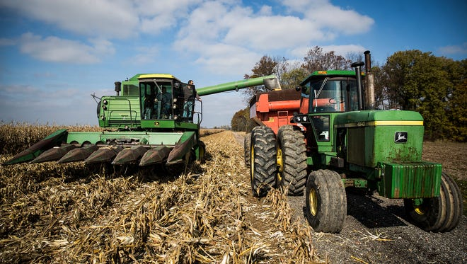 Randolph County farmers joined efforts to harvest Joe Hottinger's more than 250 acres Friday afternoon. Hottinger died in a motorcycle accident earlier this year.