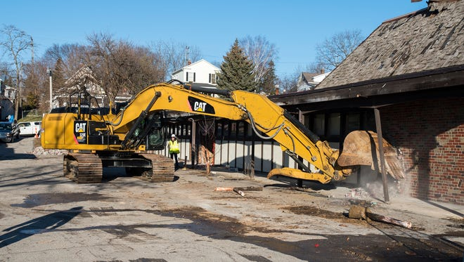 A bulldozer from DP Schweihofer Excavating, Inc., demolishes one of the buildings of the St. Clair Inn Feb. 26.