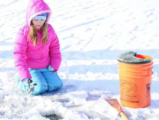 Vanessa Dresser waits for a bite while ice fishing