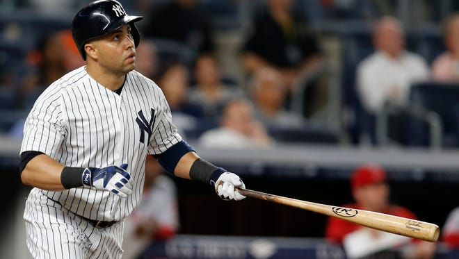 New York Yankees right fielder Carlos Beltran (36) watches his eight-inning, three-run home run clear the right field wall during a baseball game against the Los Angeles Angels at Yankee Stadium in New York, Monday, June 6, 2016.