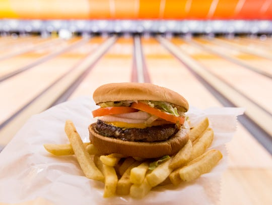 The Hebert Burger and fries at Acadiana Lanes Feb,