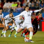 United States' Carli Lloyd (10) scores a goal on a penalty kick against Costa Rica during the first half of a CONCACAF Olympic qualifying tournament soccer match Wednesday, Feb. 10, 2016, in Frisco, Texas. (AP Photo/Tony Gutierrez)