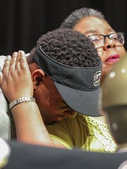Pendleton High School senior Brad Johnson, left, gets a hug from his mother Wendy Johnson, after signing a letter of intent to play for the University of South Carolina football team, on Wednesday, February 1, during an assembly at the school in Pendleton.