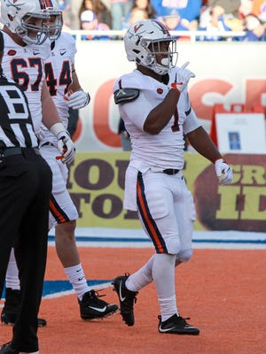 Virginia running back Jordan Ellis (1) reacts after scoring a touchdown against Boise State in the first half.