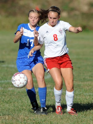 Zanesville's Allie Murphy and Rosecrans' Darby Lynch battle for possession during the Bishops' 1-0 victory over the Blue Devils on Thursday during a 2015 game at Rosecrans. The school's all-time leading scorer, Lynch signed a scholarship offer with Wheeling Jesuit on Tuesday.