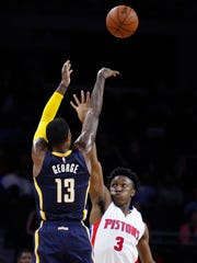 Pacers forward Paul George (13) takes a shot over Detroit