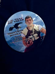Image of Jonathan Madrid on a button.