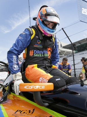 IndyCar driver Stefan Wilson gets into his car for his rookie orientation  practice for the 100th running of the Indianapolis 500 Monday, May 16, 2016, afternoon at the Indianapolis Motor Speedway.