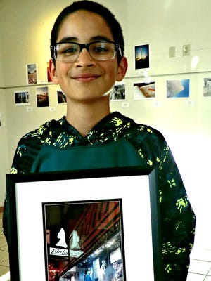 Ahmoni Gonzalez holds his grand-prize winning photograph in the Teen Photo Contest.