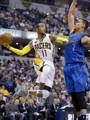 Indiana Pacers guard Monta Ellis (11) looks to pass around Dallas Mavericks forward Dwight Powell (7) in the first half of their game Wednesday, October 26, 2016, evening at Bankers Life Fieldhouse.
