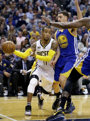 Indiana Pacers guard Monta Ellis (11) passes around Golden State Warriors guard Klay Thompson (11) in the first half of their game Monday, November 21, 2016, afternoon at Bankers Life Fieldhouse.