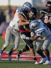 North Central's Sam Fisher (80) is tackled by Hamilton