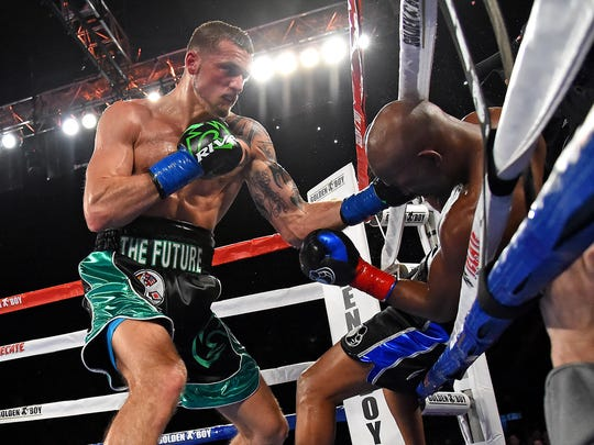 Bernard Hopkins is knocked out of the ring by Joe Smith Jr. in the seventh round of their light heavyweight boxing fight at The Forum in Inglewood, Calif.