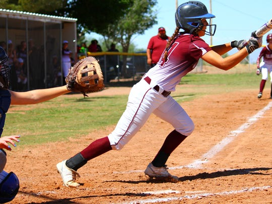 Tularosa eighth-grader Jordan Gaston lays down a squeeze bunt during the bottom of the second inning Saturday afternoon.
