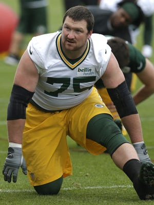 Green Bay Packers tackle Bryan Bulaga (75) is shown during organized team activities Tuesday, May 23, 2017 in Green Bay.