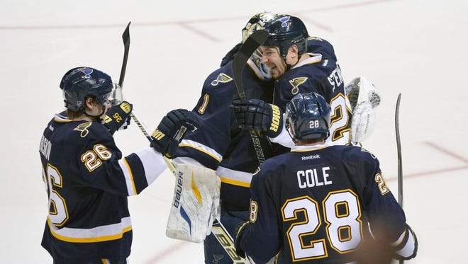 St. Louis Blues teammates celebrate defeating the Chicago Blackhawks in a shootout at Scottrade Center.
