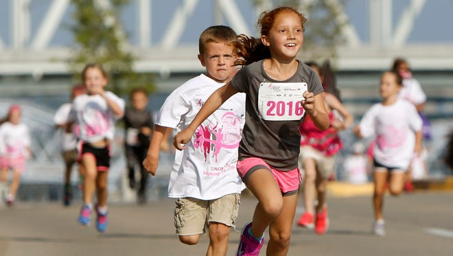 Mara Singh, 7, daughter of Christy Singh of Liberty Township, won the Kids Dash for 5- to 8-year-olds Saturday at the Susan G. Koman Race for a Cure event Downtown on the riverfront.