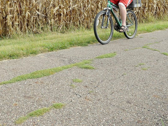 A cyclist on the T.J. Evans Bike Trail in Newark. Licking County commissioners have approved the purchase of a 40-acre plot of farmland near Centerburg that will link the Ohio to Erie bike trail between Delaware and Knox counties.