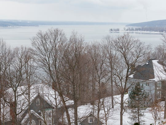 Parts of Cayuga Lake looking north of the west end of Reach Run Road in the Town of Lansing had a thin skim of ice on it Thursday morning. The ice had broken up by mid afternoon.