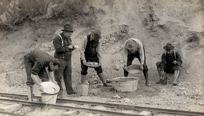 he image of unidentified five men gold panning was used to produce a postcard.