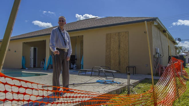 Cape Coral resident Brian Eberz, poses for a portrait at his home on 1811 Beach Parkway West on Feb. 26. The house is  uninhabitable due to the damage from the Jan. 9 tornado.