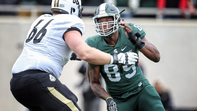 Oct 3, 2015; East Lansing, MI, USA; Michigan State Spartans defensive end Shilique Calhoun (89) is defended by Purdue Boilermakers offensive tackle Cameron Cermin (66) during the 1st quarter of a game at Spartan Stadium. Mandatory Credit: Mike Carter-USA TODAY Sports