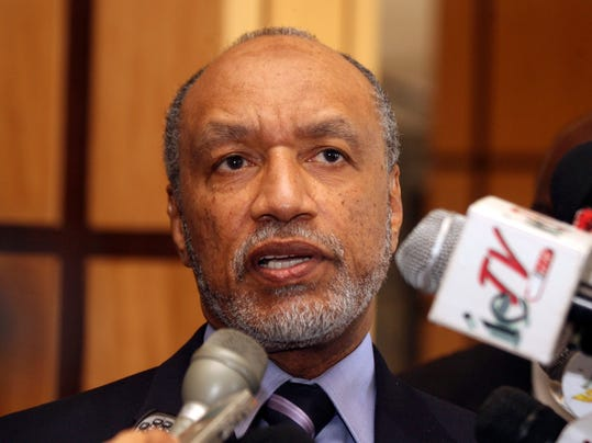 """FILE - In this May 10, 2011 file picture of Mohamed bin Hammam, chief of the Asian Football Confederation, as he talks to local media in Port of Spain, Trinidad & Tobago. Organizers of the 2022 World Cup in Qatar on Sunday June 1, 2014 denied fresh allegations of wrongdoing after a British newspaper report questioned the integrity of choosing the emirate as tournament host. The Sunday Times said a """"senior FIFA insider"""" had provided """"hundreds of millions of emails, accounts and other documents"""" detailing payments totaling $5 million that Qatari official Mohamed bin Hammam allegedly gave football officials to build support for the bid. (AP Photo/Shirley Bahadur, File)"""