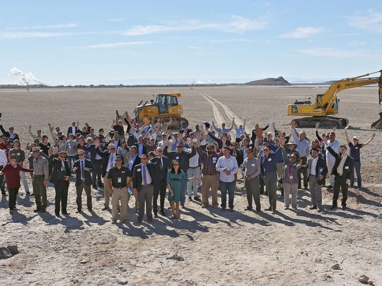 A large group gathers for a photograph during the groundbreaking of the Red Hill Bay restoration project at the Salton Sea on Nov. 5, 2015.