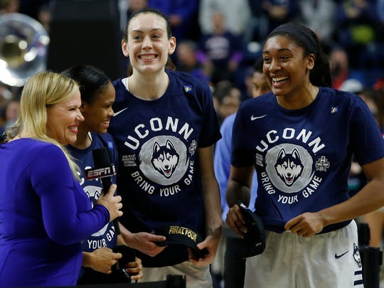 (L to R)Connecticut Huskies guard Moriah Jefferson (4), forward Breanna Stewart (30) and forward Morgan Tuck (3) celebrate after defeating the Texas Longhorns in the finals of the Bridgeport regional of the women's NCAA tournament at Webster Bank Arena.