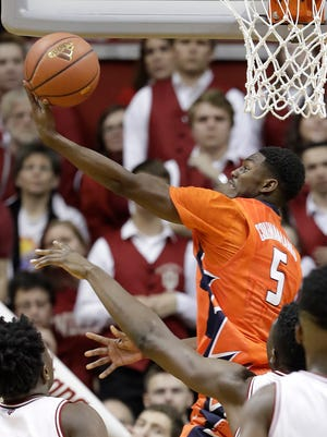 Illinois's Jalen Coleman-Lands puts up a shot during the second half of an NCAA college basketball game against Indiana, Saturday, Jan. 7, 2017, in Bloomington, Ind. Indiana defeated Illinois 96-80. (AP Photo/Darron Cummings)