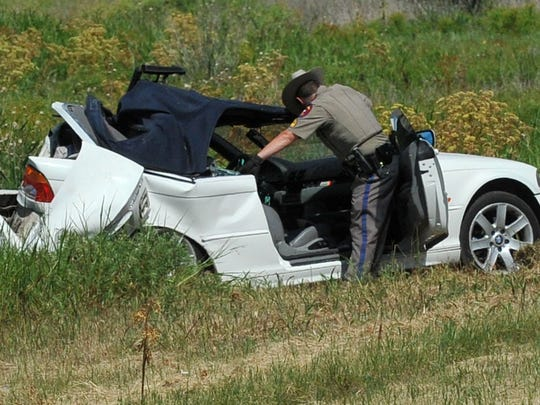 A Texas Department of Public Safety trooper works the scene of a fatal two-vehicle accident Tuesday afternoon 3 miles north of Henrietta on U.S. 287. DPS is investigating the accident.