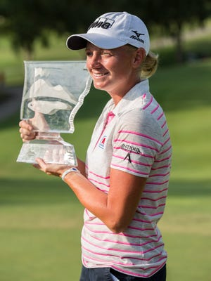 Stacy Lewis celebrates her win at Pinnacle Country Club.