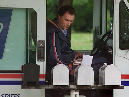 2001 file photo of Letter carrier Paul Bryant, who  found a person who was ill while on his mail route and called 911.