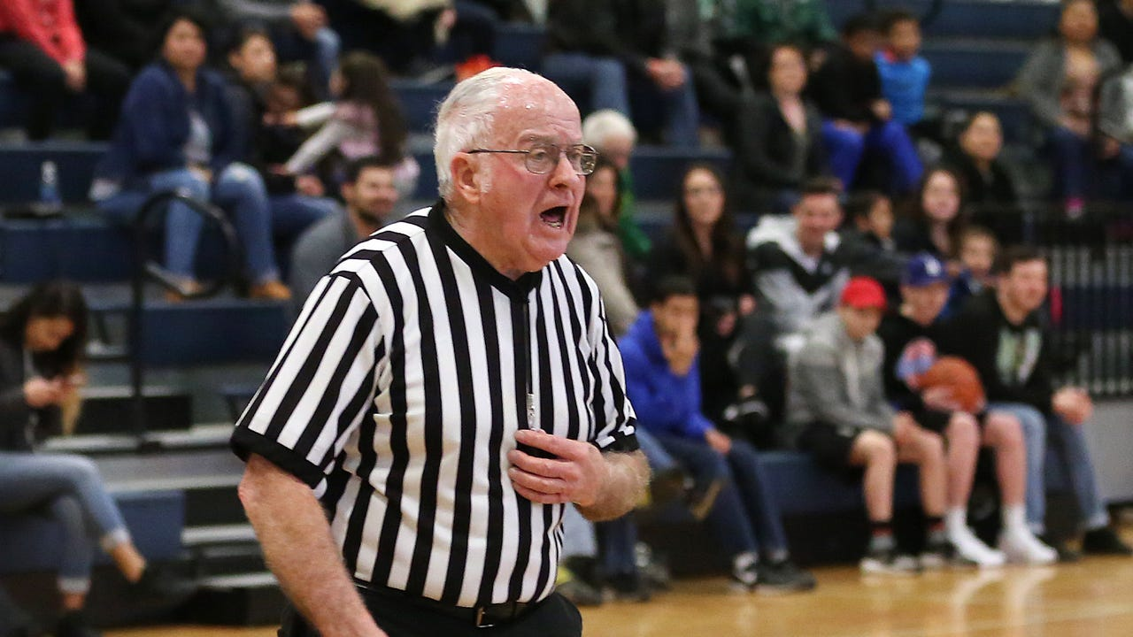 Millard Bates, 86, is a legend on the basketball court. Watch him officiate a Skyball playoff game on Feb. 8, 2017.