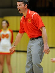 Mater Dei's head coach Kurt Wildeman yells down court during the first round of the SIAC Tournament against Castle at Castle High School in Newburgh, Tuesday, Jan. 10. 2017. Castle beat Mater Dei 78-41.