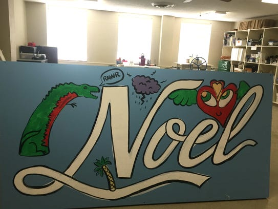 A mural painted by youth in one of the Noel Community