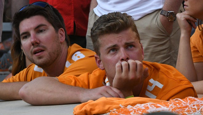 A Tennessee fan looks dejected during the Tennessee Volunteers vs. Georgia Bulldogs game at Neyland Stadium in Knoxville, Tennessee on Saturday, September 30, 2017.