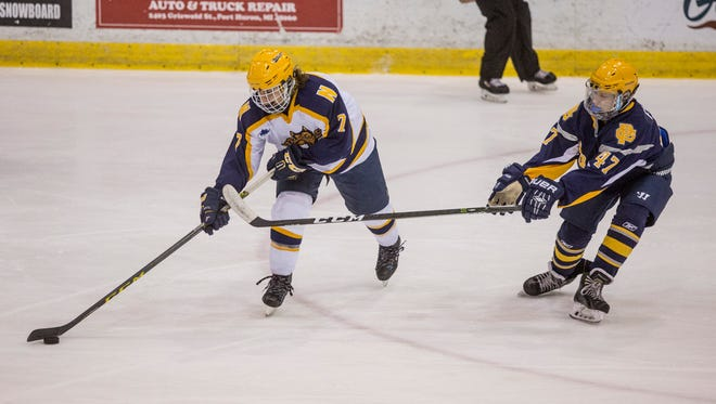 Port Huron Northerns' Chris Longo passes the puck in front of Grosse Pointe South's Jake Fillmore during a hockey game Wednesday, Jan. 25, 2017 at McMorran Arena.