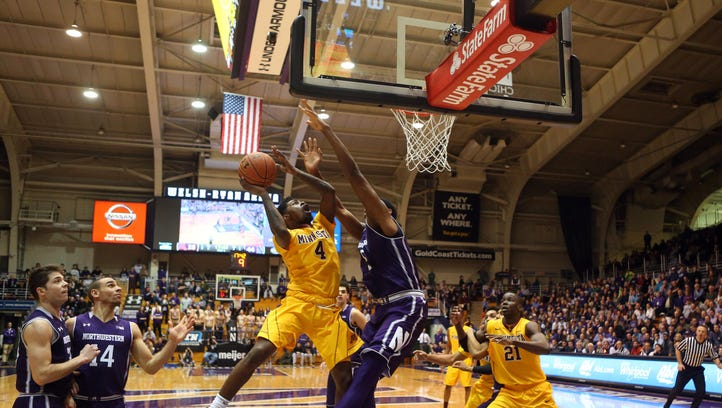 Minnesota Golden Gophers guard Kevin Dorsey (4) attempts a shot while Northwestern Wildcats center Dererk Pardon (5) defends during the second half Thursday at Welsh-Ryan Arena in Evanston, Illinois.