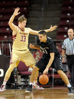 Binghamton center Dusan Perovic maneuvers in the post against Boston College's Patrick Heckmann during the second half of a Dec. 14 game at Silvio O. Conte Forum. Perovic will miss the rest of the season with a torn ACL.